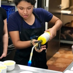 Andrea torching the creme brulee